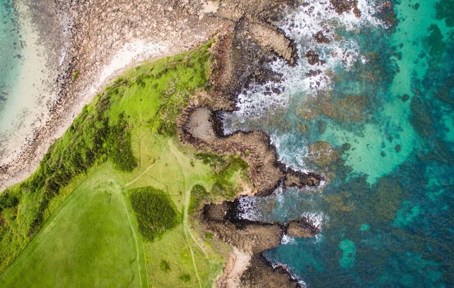 Aerial shot of land and sea